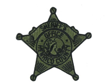 subdued badge